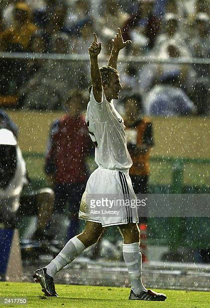 David Beckham of Real Madrid celebrates during the pre-season friendly match between FC Tokyo and Real Madrid on August 5, 2003 at the National...