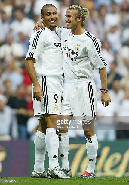 David Beckham of Real Madrid celebrates with teammate Ronaldo during the Spanish Primera Liga match between Real Madrid and Valladolid at the...