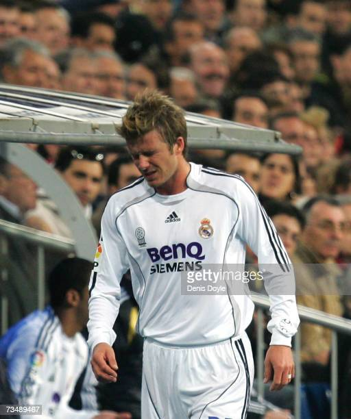 David Beckham of Real Madrid goes to the dugout after getting injured during the Primera Liga match between Real Madrid and Getafe at the Santiago...