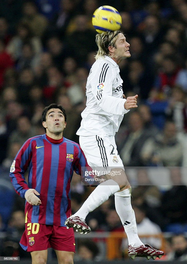 David Beckham of Real Madrid heads the ball beside Deco of Barcelona during a Primera Liga match between Real Madrid and F.C. Barcelona at the Bernabeu on November 19, 2005 in Madrid, Spain. Barcelona won 3-0.