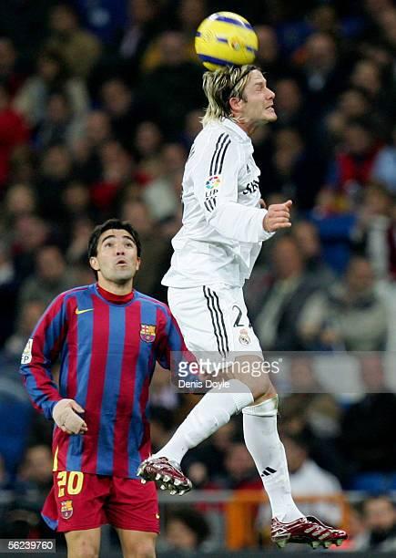 David Beckham of Real Madrid heads the ball beside Deco of Barcelona during a Primera Liga match between Real Madrid and FC Barcelona at the Bernabeu...