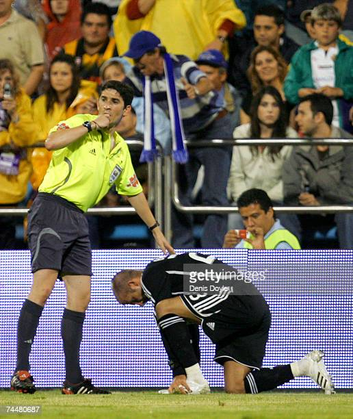 David Beckham of Real Madrid is attended be referee Undiano Mallenco after getting injured in the Primera Liga match between Real Zaragoza and Real...