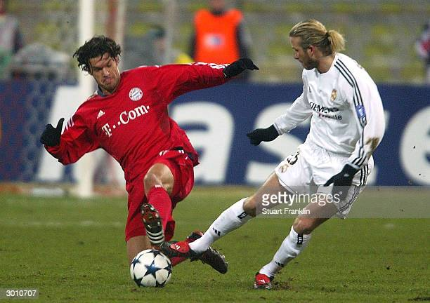 David Beckham of Real Madrid is challenged by Michael Ballack of Bayern Munich during the UEFA Champions League match between Bayern Munich and Real...