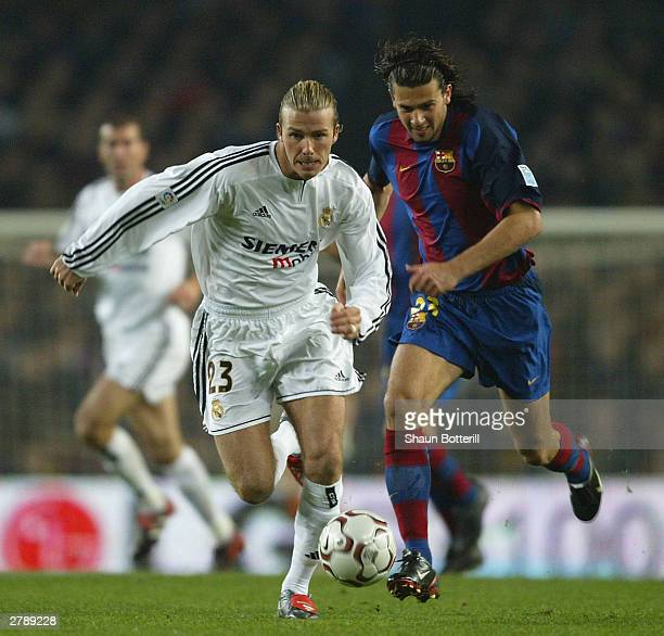 David Beckham of Real Madrid is challenged by Motta of Barcelona during the Spanish Primera Liga match between Barcelona and Real Madrid at the Nou...