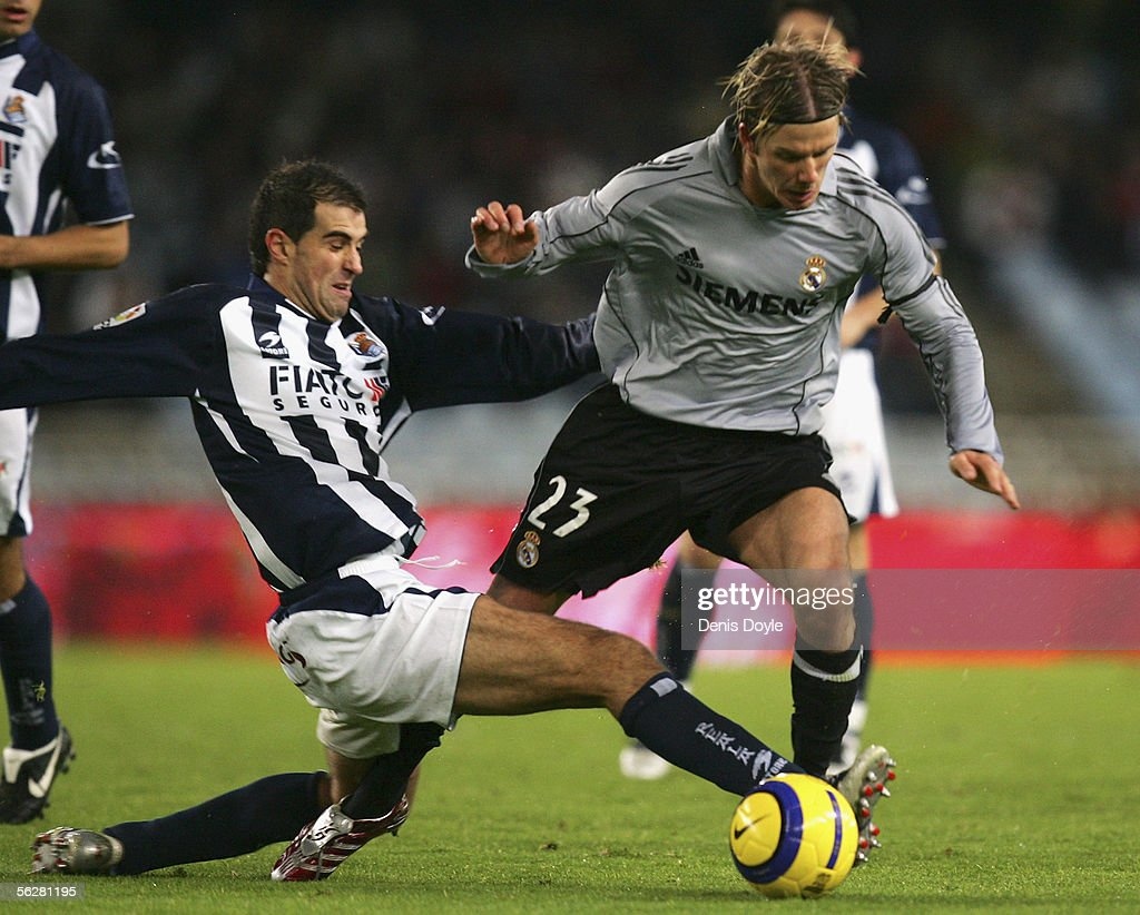 David Beckham (R) of Real Madrid is foulded by Gaizka Garitano of Real Sociedad during a Primera Liga match between Real Sociedad and Real Madrid at the Anoeta stadium on November 27, 2005 in San Sebastian, Spain.
