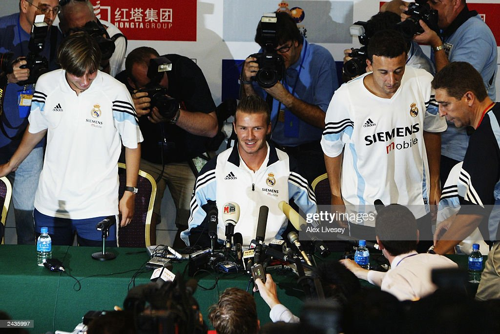 David Beckham of Real Madrid is mobbed by the media as he arrives for his first press conference on July 30, 2003 at the Hongta Sports Centre in Kunming, China.