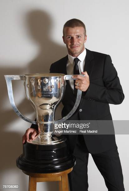 David Beckham of Real Madrid poses with the Liga trophy at the Santiago Bernabeu stadium on June 18, 2007 in Madrid, Spain.