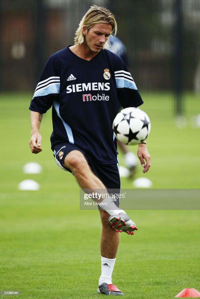 David Beckham of Real Madrid practises keeping the ball up during a training session on July 30, 2003 at the Hongta Sports Centre in Kunming, China.