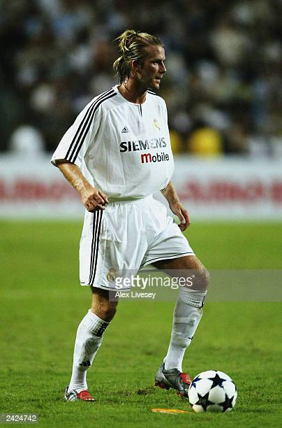 David Beckham of Real Madrid runs with the ball during the Pre-Season Friendly match between Hong Kong XI and Real Madrid held on August 8, 2003 at...