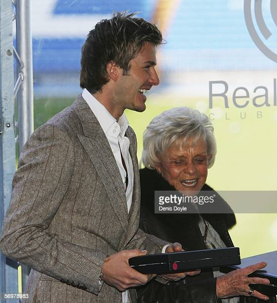 David Beckham of Real Madrid smiles while attending a UEFA ceremony celebrating Real Madrid's 50 year history in UEFA football at the Santiago...