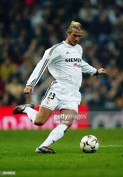 David Beckham of Real Madrid strikes the ball during the Primera Liga match between Real Madrid and Deportivo La Coruna on December 14 2003 at the...