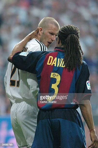 David Beckham of Real Madrid talks with teammate Edgar Davids during their game against Barcelona at Santiago Bernabeu Stadium on April 25 2004 in...