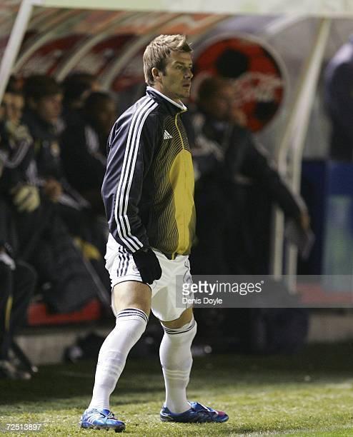 David Beckham of Real Madrid watches his team play Osasuna during the Primera Liga match between Osasuna and Real Madrid at the Reyno de Navarra...