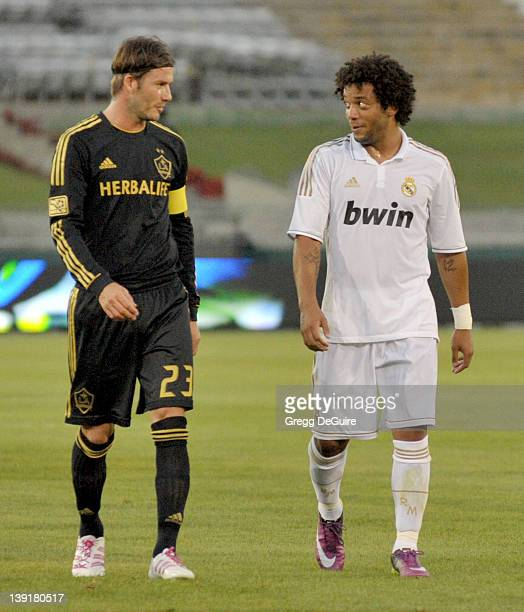 David Beckham of the LA Galaxy and Marcelo of Real Madrid at the 2011 Herbalife World Football Challenge at the Los Angeles Memorial Coliseum on July...