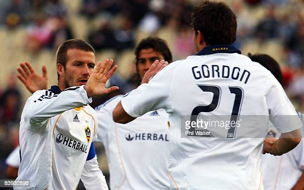 David Beckham of the LA Galaxy congratulates goal scorer Alan Gordon during the match between the Oceania All Stars and the LA Galaxy at Mount Smart...