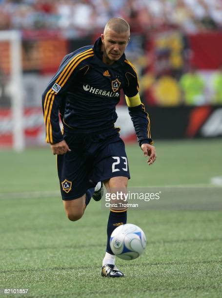 David Beckham of the LA Galaxy plays the ball against the New York Red Bulls at Giants Stadium in the Meadowlands on July 19, 2008 in East...