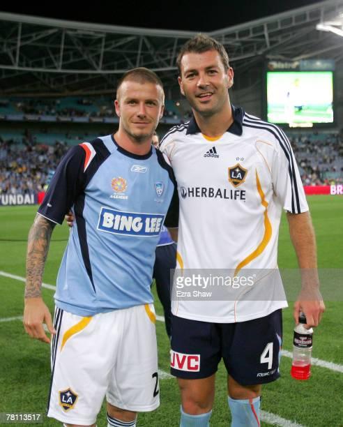 David Beckham of the LA Galaxy poses with Mark Rudan of Sydney FC after the Hyundai Club Challenge match between Sydney FC and the LA Galaxy at...