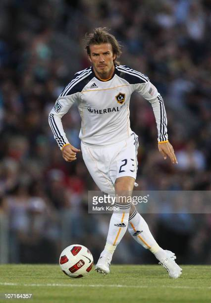 David Beckham of the Galaxy runs the ball during the friendly match between the Newcastle Jets and the LA Galaxy at EnergyAustralia Stadium on...