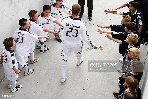 David Beckham of the LA Galaxy walks out for the match between the Oceania All Stars and the LA Galaxy at Mount Smart Stadium on December 6 2008 in...