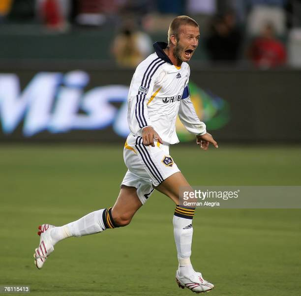 David Beckham of the Los Angeles celebrates after scoring a goal during the MLS Superliga match between DC United and Los Angeles Galaxy at the Home...
