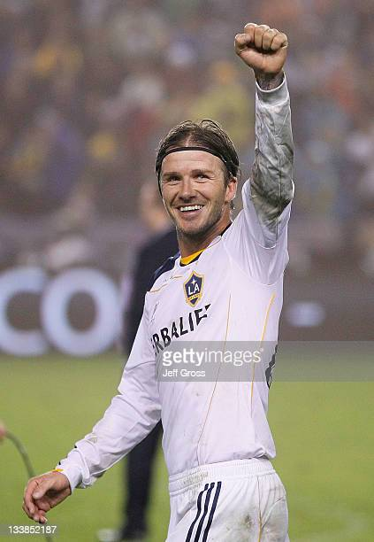 David Beckham of the Los Angeles Galaxy acknowledges the fans after defeating the Houston Dynamo 1-0 to win the 2011 MLS Cup at The Home Depot Center...