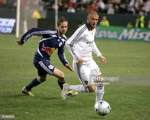 David Beckham of the Los Angeles Galaxy and Hunter Freeman of the New York Red Bulls in action during their MLS game against the New York Red Bulls...