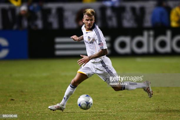 David Beckham of the Los Angeles Galaxy attacks the defense of the Houston Dynamo during their MLS Western Conference Championship game at The Home...