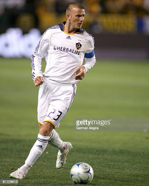 David Beckham of the Los Angeles Galaxy attacks the defensive line of the Kansas City Wizards during the Major League Soccer match between the Kansas...