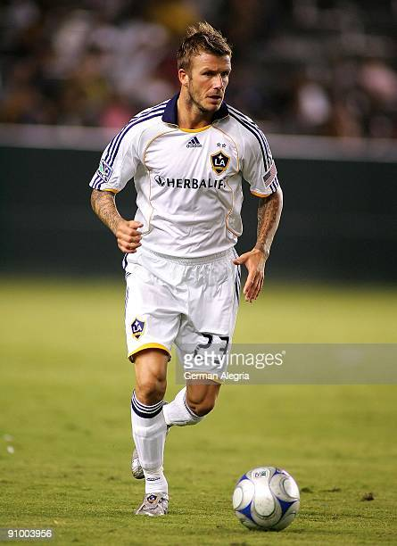 David Beckham of the Los Angeles Galaxy attacks the defensive line of Toronto FC during the game at The Home Depot Center on September 19 2009 in...