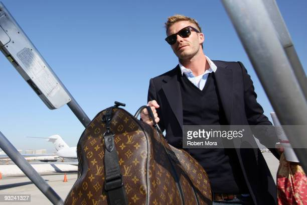 David Beckham of the Los Angeles Galaxy boards the team's charter flight to Seattle ahead of their MLS Cup game on Sunday against Real Salt Lake on...