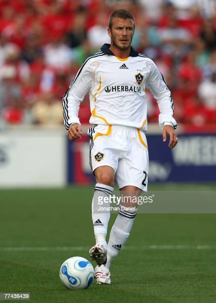 David Beckham of the Los Angeles Galaxy brings the ball upfield against the Chicago Fire at Toyota Park October 21 2007 in Bridgeview Illinois The...