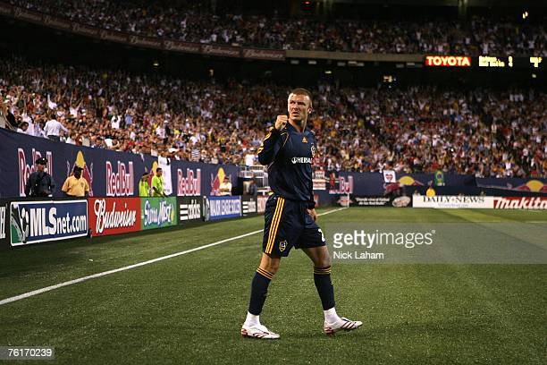 David Beckham of the Los Angeles Galaxy celebrates after a corner kick led to his teams third goal of the night against the New York Red Bulls at...