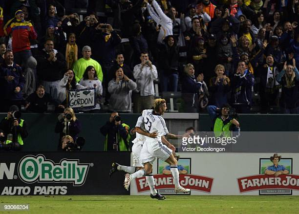David Beckham of the Los Angeles Galaxy celebrates with teammate Landon Donovan after Donovan converted a penalty kick for a goal to take a 20 lead...