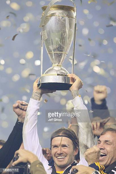 David Beckham of the Los Angeles Galaxy celebrates with the Philip F Anschutz Trophy after defeating the Houston Dynamo 10 in the 2011 MLS Cup at The...