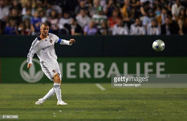 David Beckham of the Los Angeles Galaxy chips a pass to midfield in the second half of their MLS match against the New England Revolution at the Home...