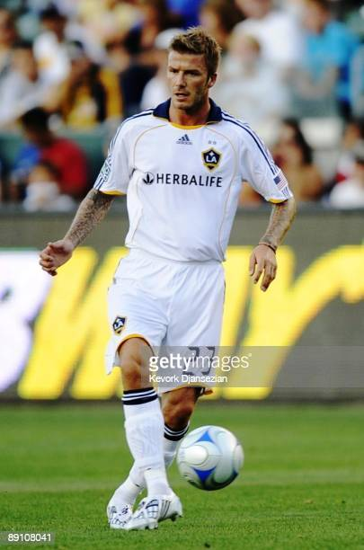 David Beckham of the Los Angeles Galaxy controls the ball during the MLS game against AC Milan at The Home Depot Center on July 19 2009 in Carson...