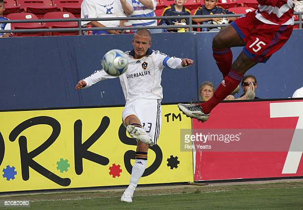 David Beckham of the Los Angeles Galaxy defends the ball from Adrian Serioux of the FC Dallas on July 27, 2008 at Pizza Hut Park in Frisco, Texas.
