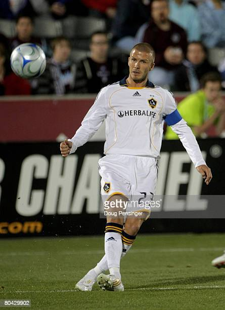 David Beckham of the Los Angeles Galaxy delivers a pass to a teammate against the Colorado Rapids at Dick's Sporting Goods Park on March 29 2008 in...