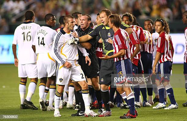 David Beckham of the Los Angeles Galaxy gets in the face of a member of Club Deportivo Chivas USA during their match on August 23 2007 at Home Depot...