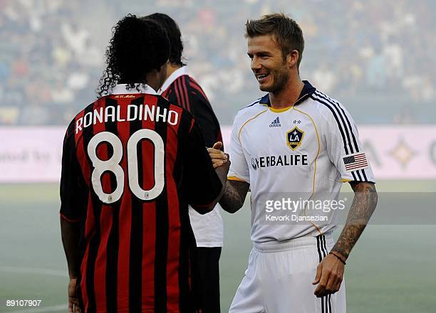 David Beckham of the Los Angeles Galaxy greets former teammate Ronaldinho of AC Milan before the MLS friendly match at The Home Depot Center on July...