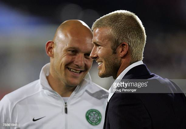 David Beckham of the Los Angeles Galaxy has a word with former Real Madrid teammate Thomas Gravesen of Glasgow Celtic FC before awarding the U17 MLS...