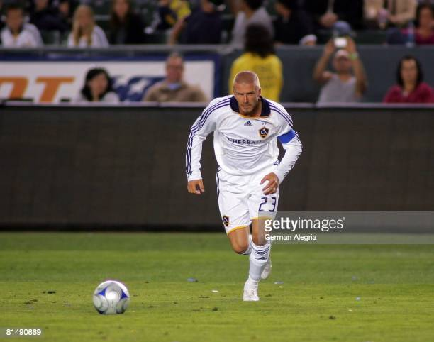 David Beckham of the Los Angeles Galaxy in action against the defensive line of the Colorado Rapids during the MLS match between the Colorado Rapids...