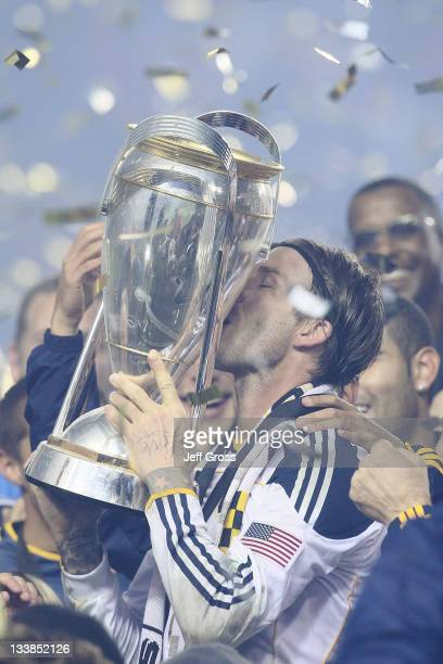 David Beckham of the Los Angeles Galaxy kisses the Philip F Anschutz Trophy after defeating the Houston Dynamo 10 in the 2011 MLS Cup at The Home...
