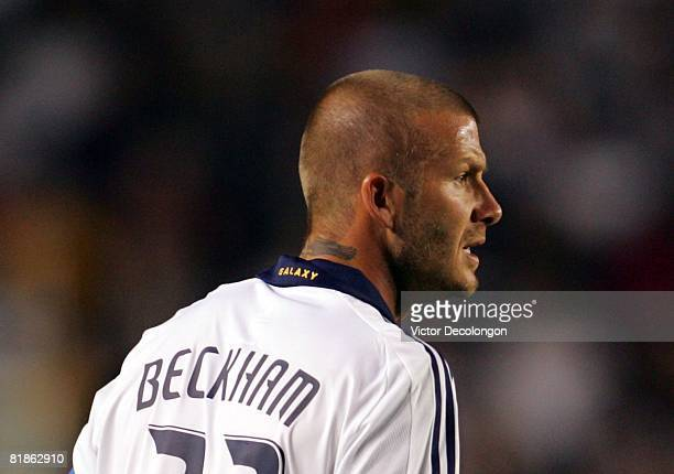 David Beckham of the Los Angeles Galaxy looks across the field to teammate Edson Buddle after a failed buildup on the attack against the New England...