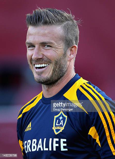David Beckham of the Los Angeles Galaxy looks on as he warms up prior to facing the Colorado Rapids at Dick's Sporting Goods Park on April 21 2012 in...