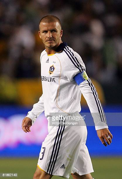 David Beckham of the Los Angeles Galaxy looks on in the second half of their MLS match against the New England Revolution at the Home Depot Center on...