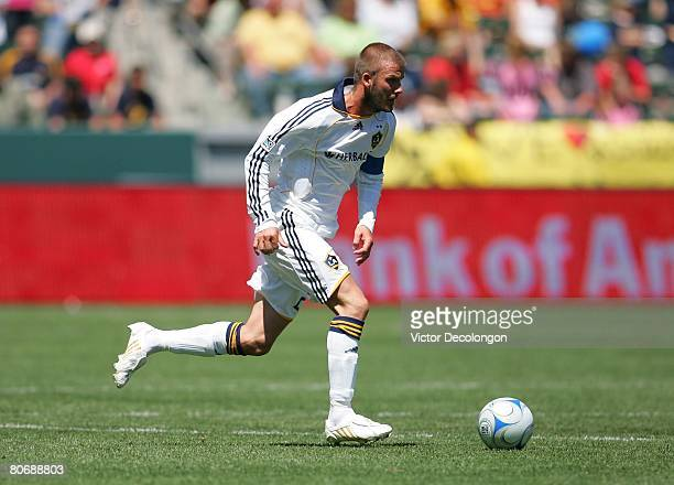 David Beckham of the Los Angeles Galaxy moves the ball across midfield in the second half against Toronto FC during their MLS game at the Home Depot...