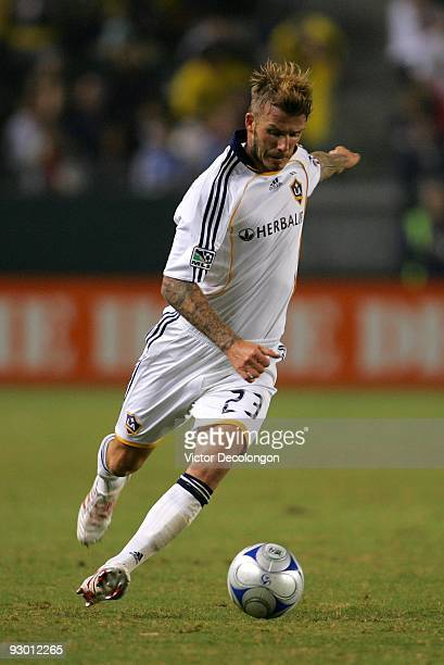 David Beckham of the Los Angeles Galaxy moves to cross the ball during Game 2 of the MLS Western Conference Semifinals match against Chivas USA at...