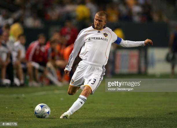 David Beckham of the Los Angeles Galaxy moves to strike the ball on a freekick in the second half of their MLS match against the New England...