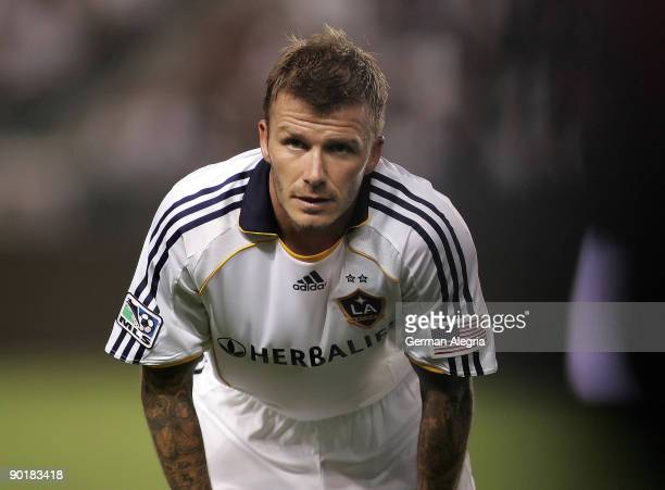 David Beckham of the Los Angeles Galaxy pauses to receive instructions from the bench during his MLS match against Chivas USA on August 29 2009 at...